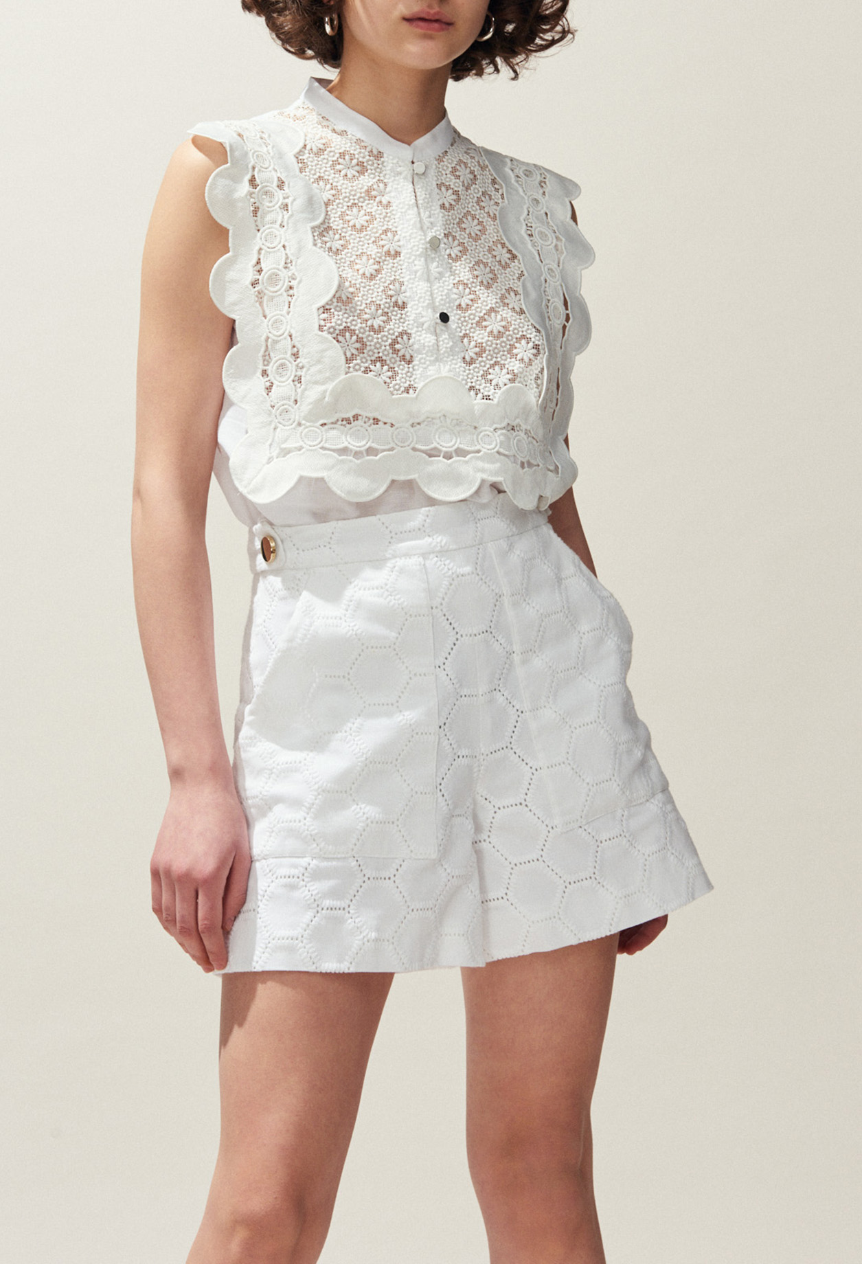 Sleeveless top with lace inserts